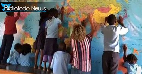 Children in Africa pray for the world with hands on the